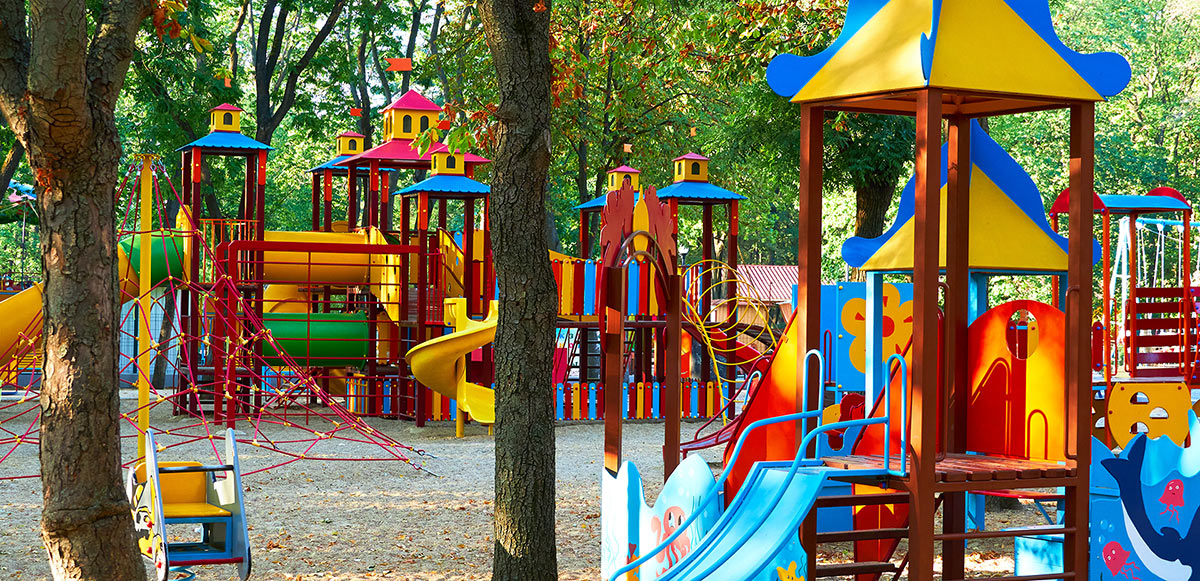 Children's playground in a city Park early in the morning, various swings and carousels